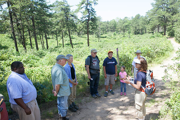 Hikers standing on trail in the Albany Pine Bush