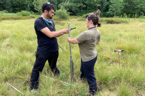 two scientist coring in the field