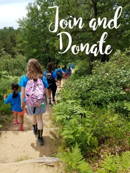 People walking on the trail. Join and donate. Link to the signup page.