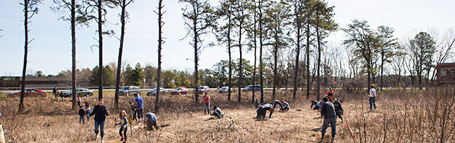 Earth Day volunteers help with habitat restoration and trash clean-up.